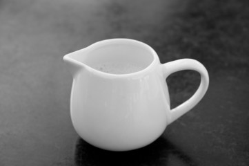 milk jug, black and white image