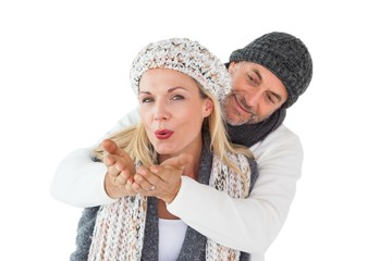 Smiling couple in winter fashion posing