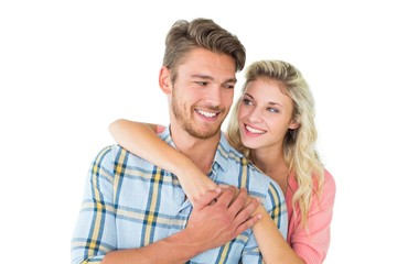 Attractive couple embracing and smiling