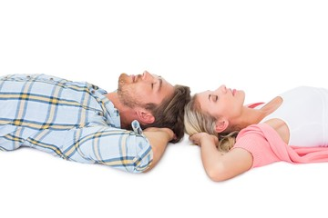 Attractive young couple sleeping peacefully
