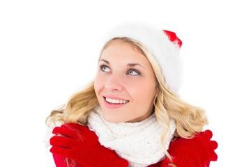 Festive blonde looking up in santa hat
