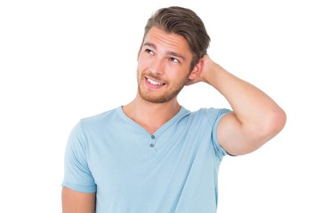 Young man posing with hands on head