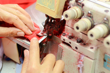 Hand of professional sewing machine