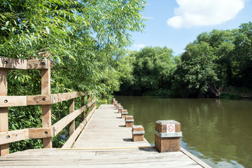 Wooden walkway by river