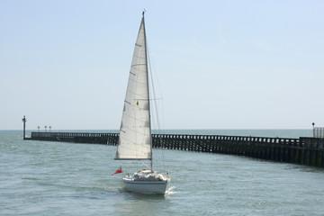 Yacht approaching Littlehampton. England