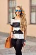 Beautiful stylish young woman on a street
