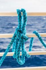 Blue Rope on White Ship Railing