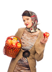 Woman with autumn apples in basket