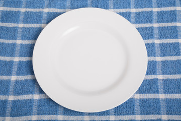 Empty Plate on Blue Towel