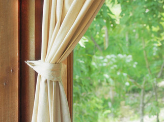beige curtain and green window view