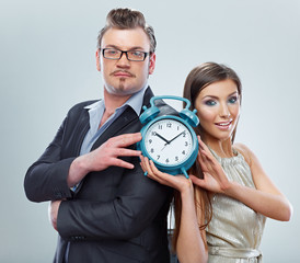 Business man and woman show watch. Business team.