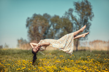 Girl hovers over the field.