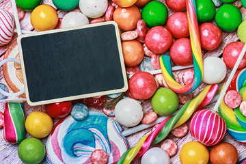blackboard for writing greetings on a lollipop and sweets