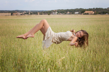 healthy woman floating in nature meadow