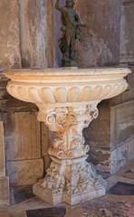 Venice - baroque stoup in church Santa Maria della Salute.
