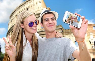Selfie - Romantic travel couple by Coliseum