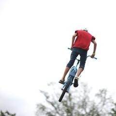Stunt cyclist's bike trick