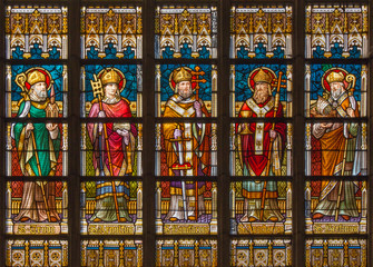 Bruges - saint bishops on the windwopane in st. Jacobs church