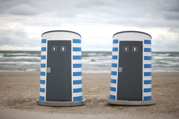 Modern public toilets on the beach; two cabins