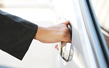 Hand business woman open car door