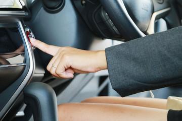 Business woman push an engine start button