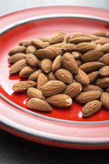 Raw almonds in plate