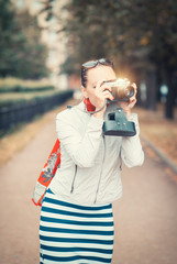 Beautiful woman with old retro camera