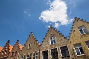 Bruges - cloud heart over the typically bick houses of the town.
