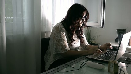 Young Girl Working at Home with Notebook