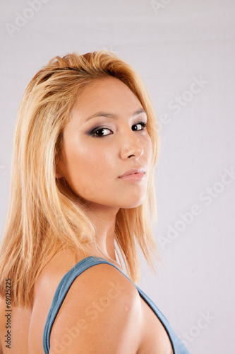 canvas print picture Blond woman looking seriously at the camera