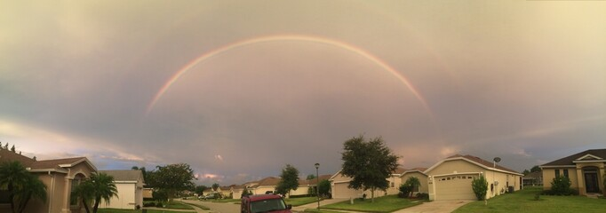 Rainbow over gated community in Florida
