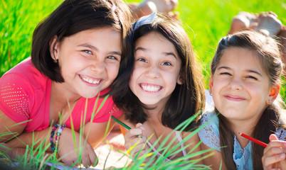 Three happy teen girls at park