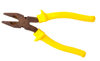 really old rusty pliers with yellow on white background