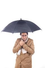 man in the coat with umbrella freezes
