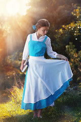 "beautiful girl in cosplay Belle of the animated film ""Beauty and"