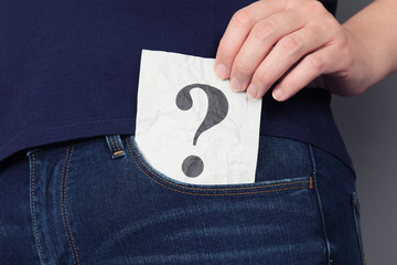 Question mark in pocket of jeans