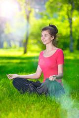 Young woman doing yoga exercises