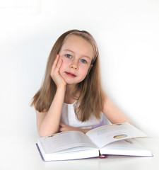 Girl reading the book. education and school concept