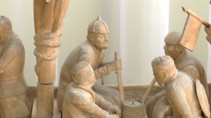 The video shows wooden sculpture of ship with the Vikings.