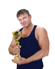 Strong man with winner cup