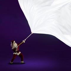 Santa Claus pulls the banner