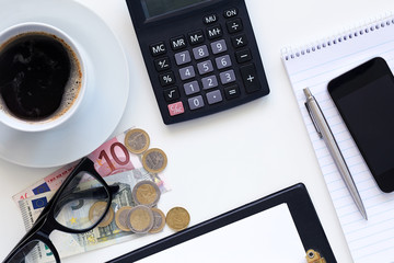 Workplaces, coffee with calculator and money