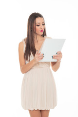 Attractive young woman holds an empty white board