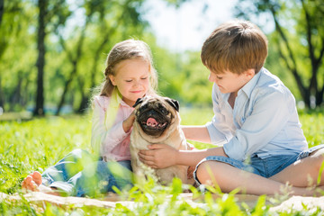 Children in park with pet