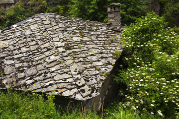 House with stone roof in the mountain