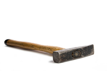Pin hammer lying on white surface