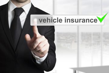 businessman pushing button vehicle insurance