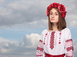 sad girl in the Ukrainian national suit