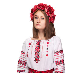 sad girl in the Ukrainian national suit