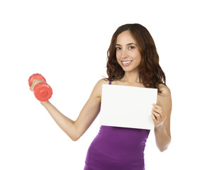 Fitness woman with a dumbbell holding an advertisement board